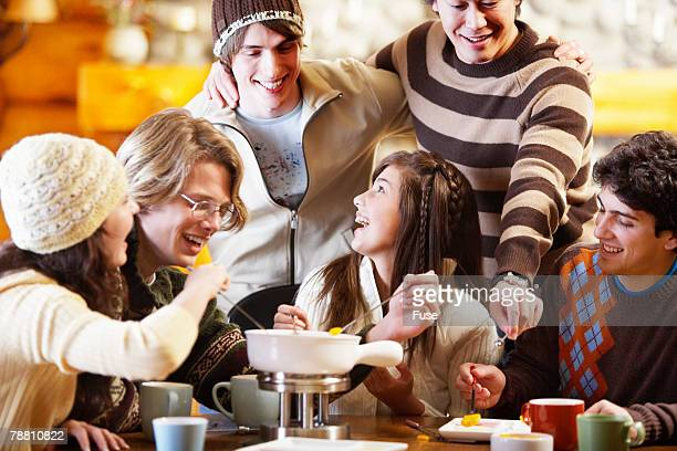 Friends Having Fondue