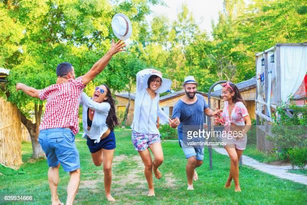 Friends having fun and dancing in nature