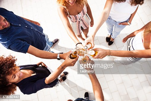 Friends having fun and drinking some beers outdoor