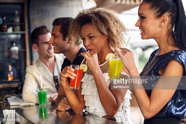 Friends having fun at the bar outdoor