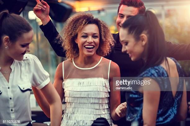 Friends having fun at the nightclub