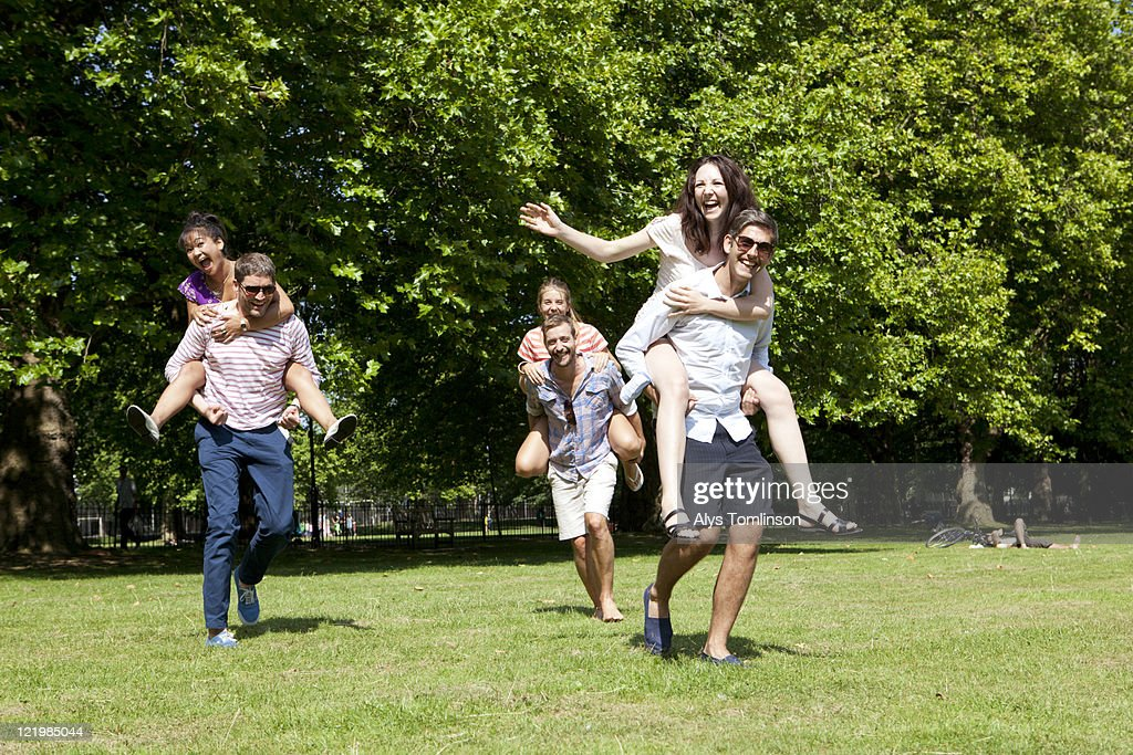 Friends Having Fun in a City Park : Stock Photo