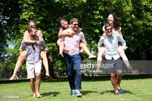 Friends Having Fun in a City Park : Stock Photo