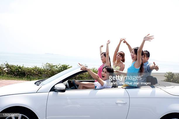 Friends Having Fun in a Convertible