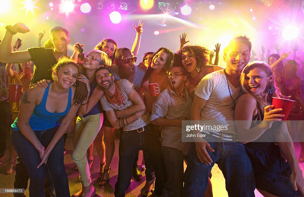 Friends having fun in a nightclub : Stock Photo