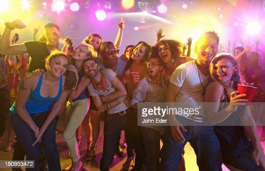 Friends having fun in a nightclub : Stock Photo