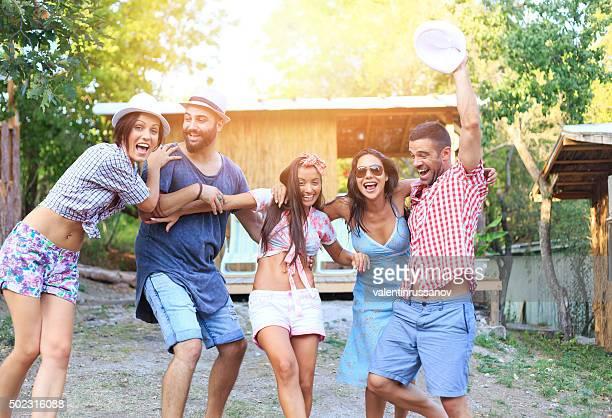 Friends having fun in front of veranda