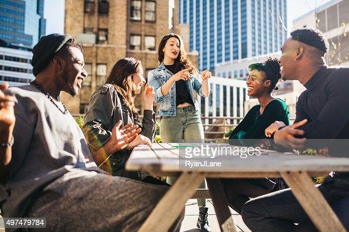 Friends Having Fun on Rooftop