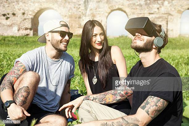 Friends having fun outdoors at the park with VR Headset