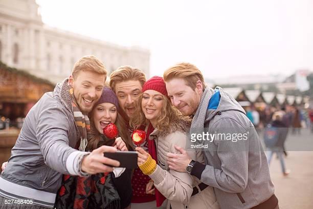 Friends having fun outdoors in winter city.