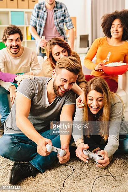 team playing video game stock photos and pictures getty images. Black Bedroom Furniture Sets. Home Design Ideas