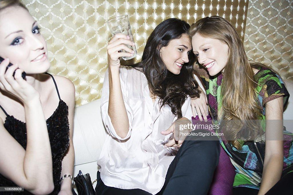 Friends having fun together at nightclub : Stock Photo
