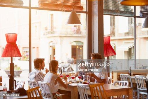 Friends having lunch in restaurant