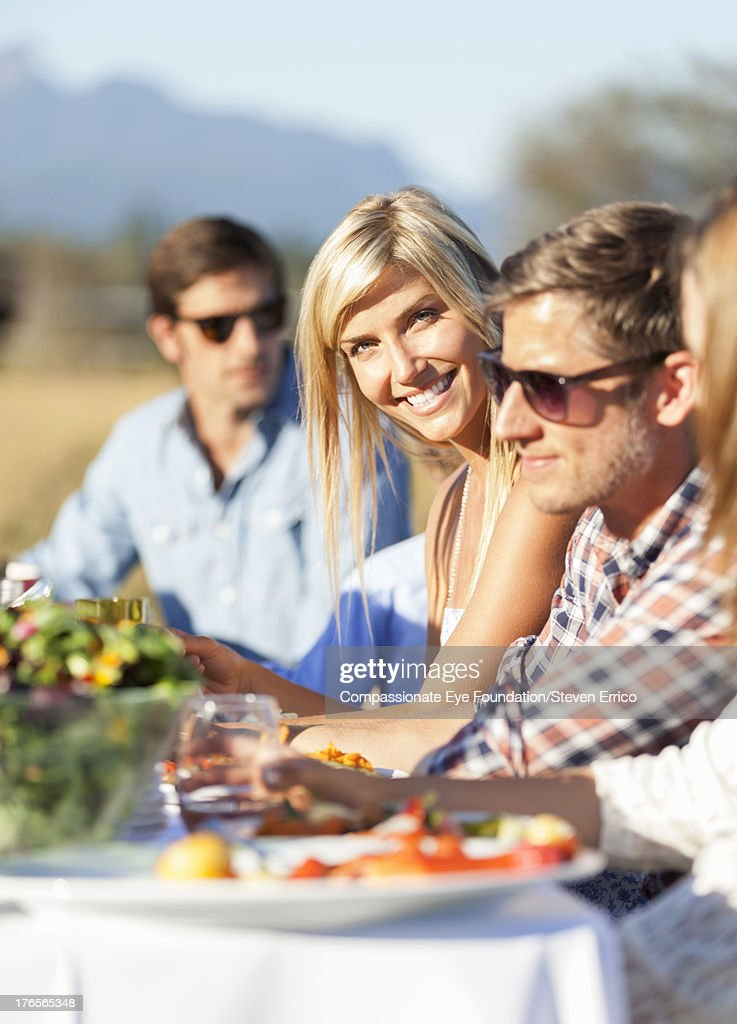 Friends having lunch together outdoors : Stock Photo