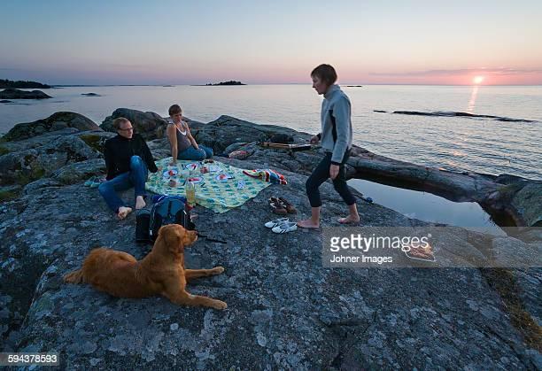 Friends having picnic at sea