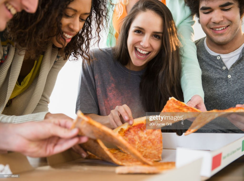 Friends having pizza together