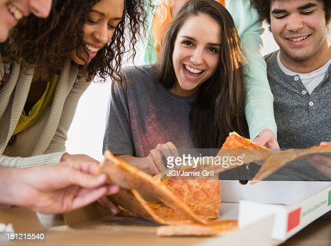 Friends having pizza together : Stock Photo
