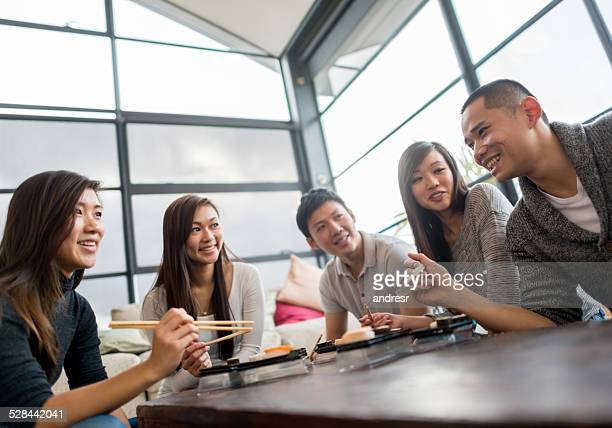 Friends having sushi
