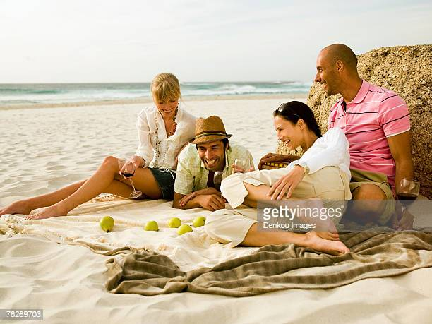 Friends having wine on the beach.