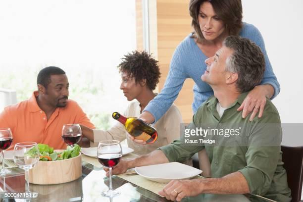 Friends having wine together at dinner