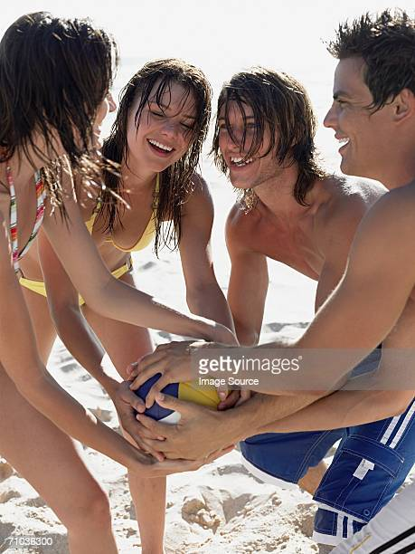 Friends holding a volleyball