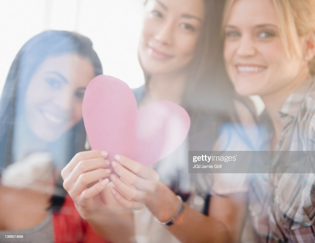 Friends holding valentine : Stock Photo