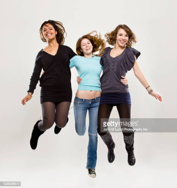 Friends hugging and jumping
