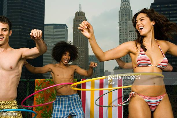 Friends Hula Hooping on Rooftop