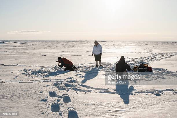 Friends Ice Fishing, Great Slave Lake, Yellowknife, Northwest Territories.