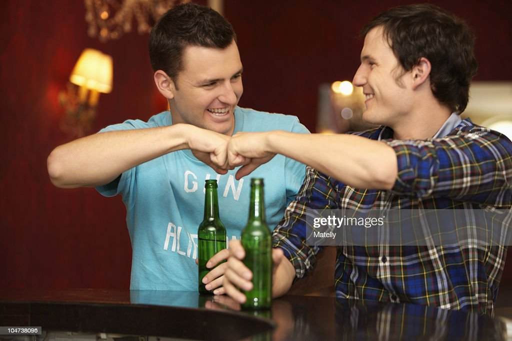 Friends in a bar / restaurant : Stock Photo