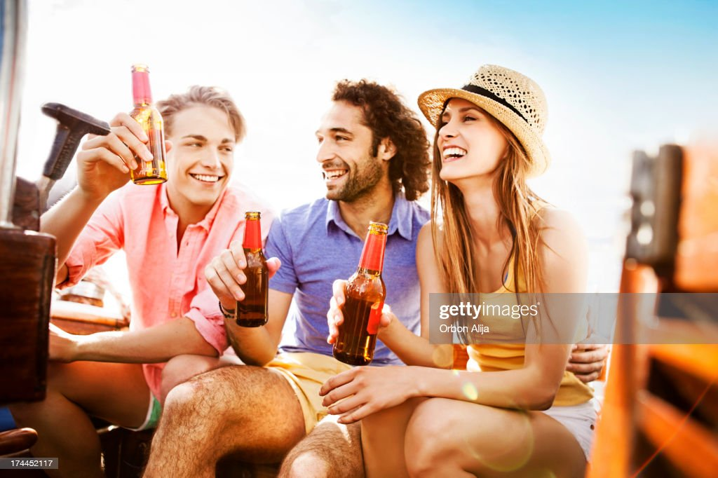 Friends in a boat : Stock Photo