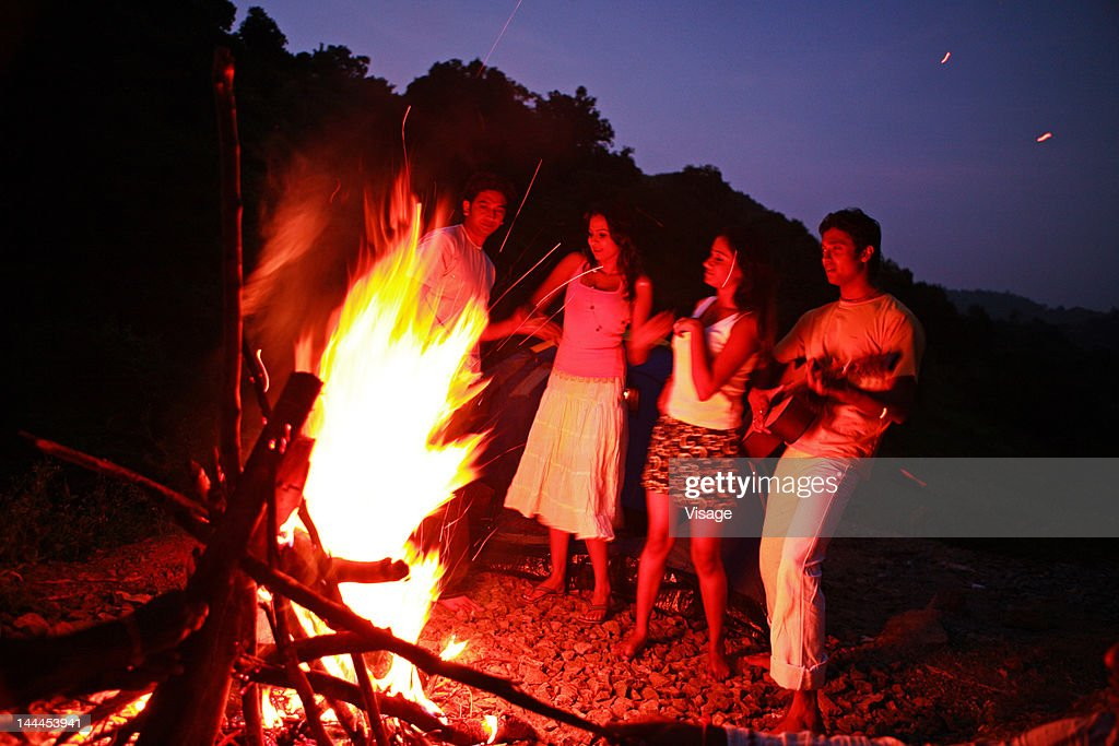 Friends in a campfire : Stock Photo