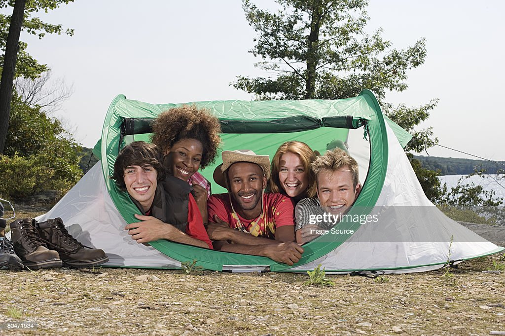 Friends in a tent : Stock Photo