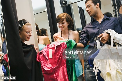 Friends in clothing store : Stock Photo