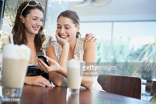Friends in coffee shop : Stock Photo