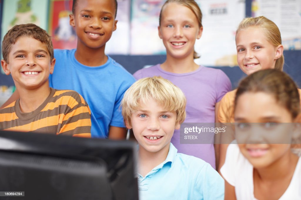 Friends in computer class : Stock Photo