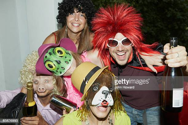 Friends in costume at party