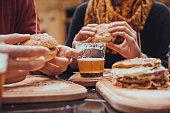 Hipster Friends In Fast Food Rastaurant. Focus Is On Beer
