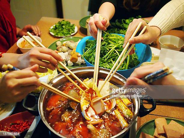 Friends in house party to eat hot pot