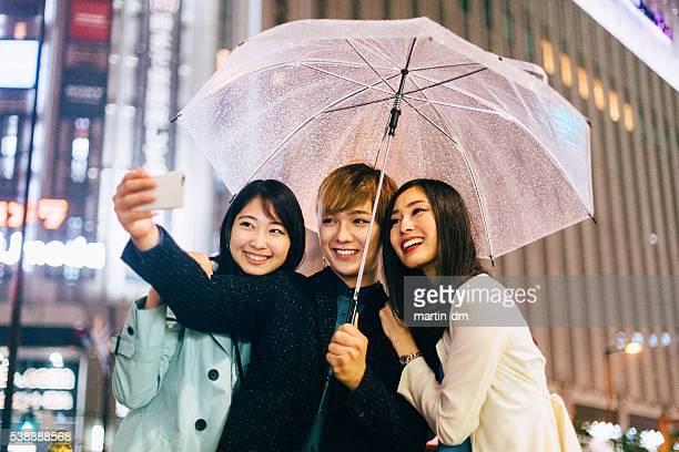 Friends in Japan taking selfie
