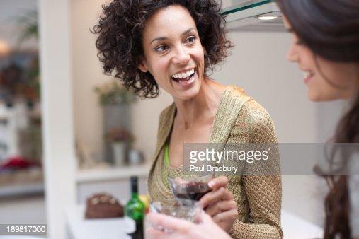 Friends in kitchen : Stock Photo
