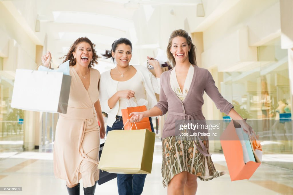 Friends in mall with shopping bags : Stock Photo