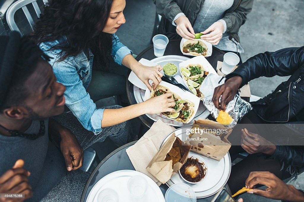 Friends in New York at Food Cart : Stock Photo