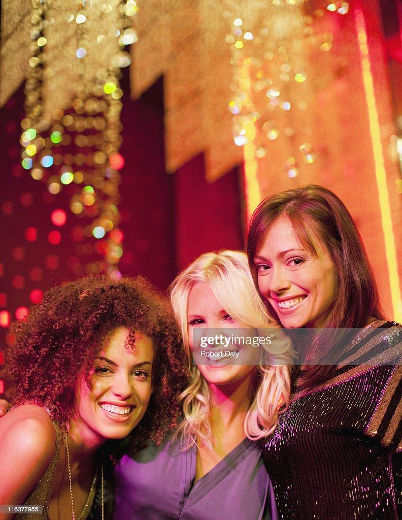 Friends in nightclub : Stock Photo