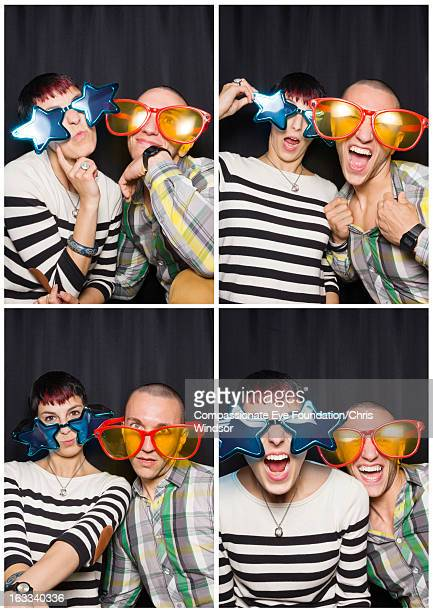 Friends in photo booth with oversized sunglasses