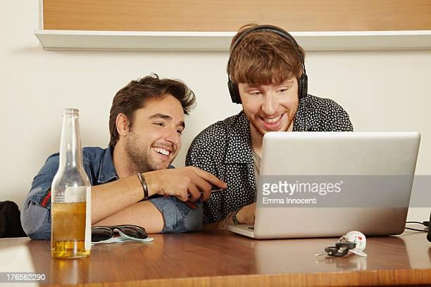 Friends indoor looking at computer screen