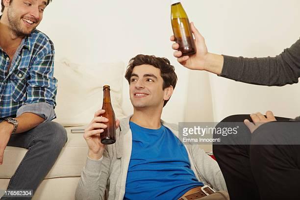 Friends indoor toasting with beer