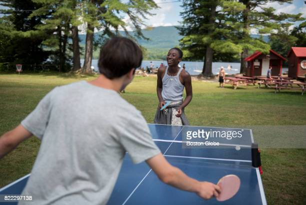 Friends Jacob Smith right and David Falis play table tennis during a sunny morning at Camp Moosilauke in Orford NH on Jul 18 2017 Camp Moosilauke is...