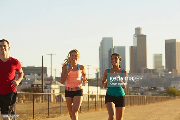 Friends jogging and laughing
