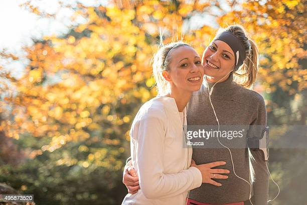 Friends jogging in autumn outdoor park